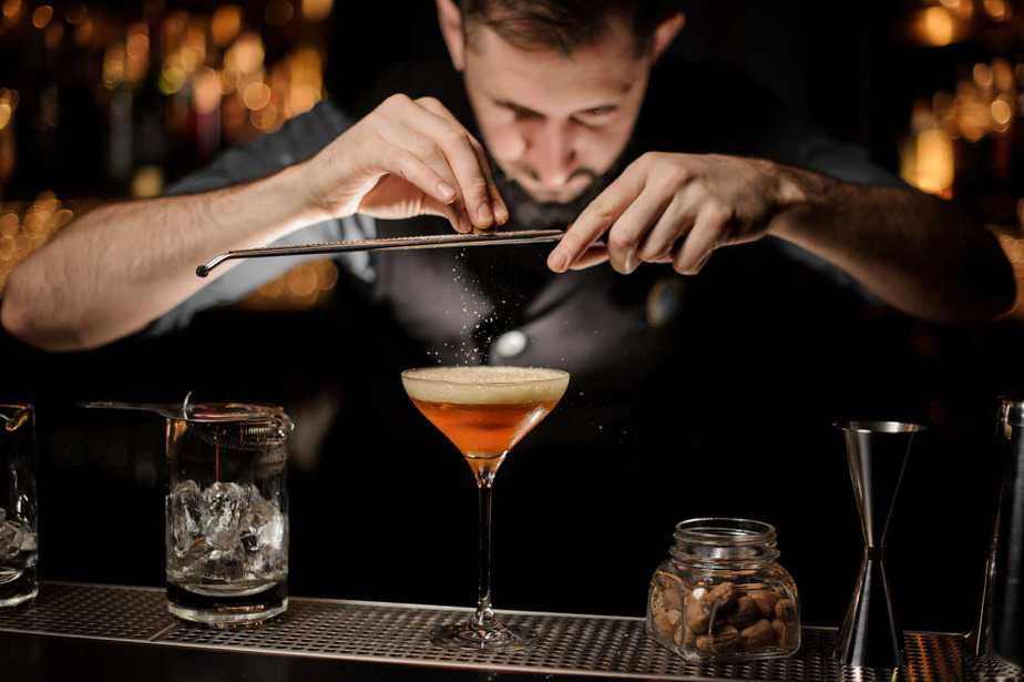 bartender-adding-to-a-cocktail
