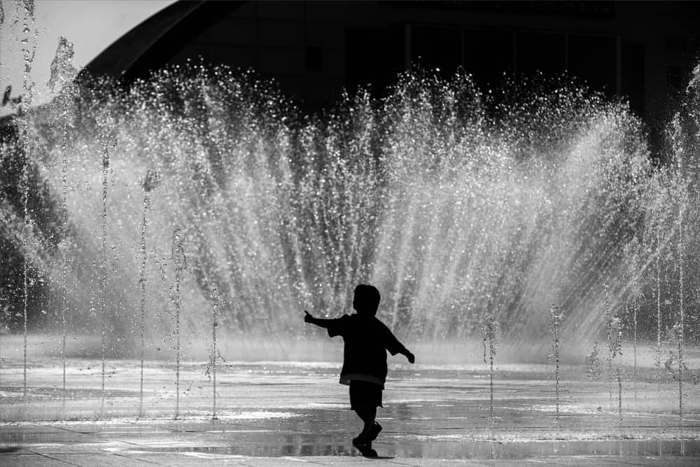 happy-a-child-playing-in-a-water